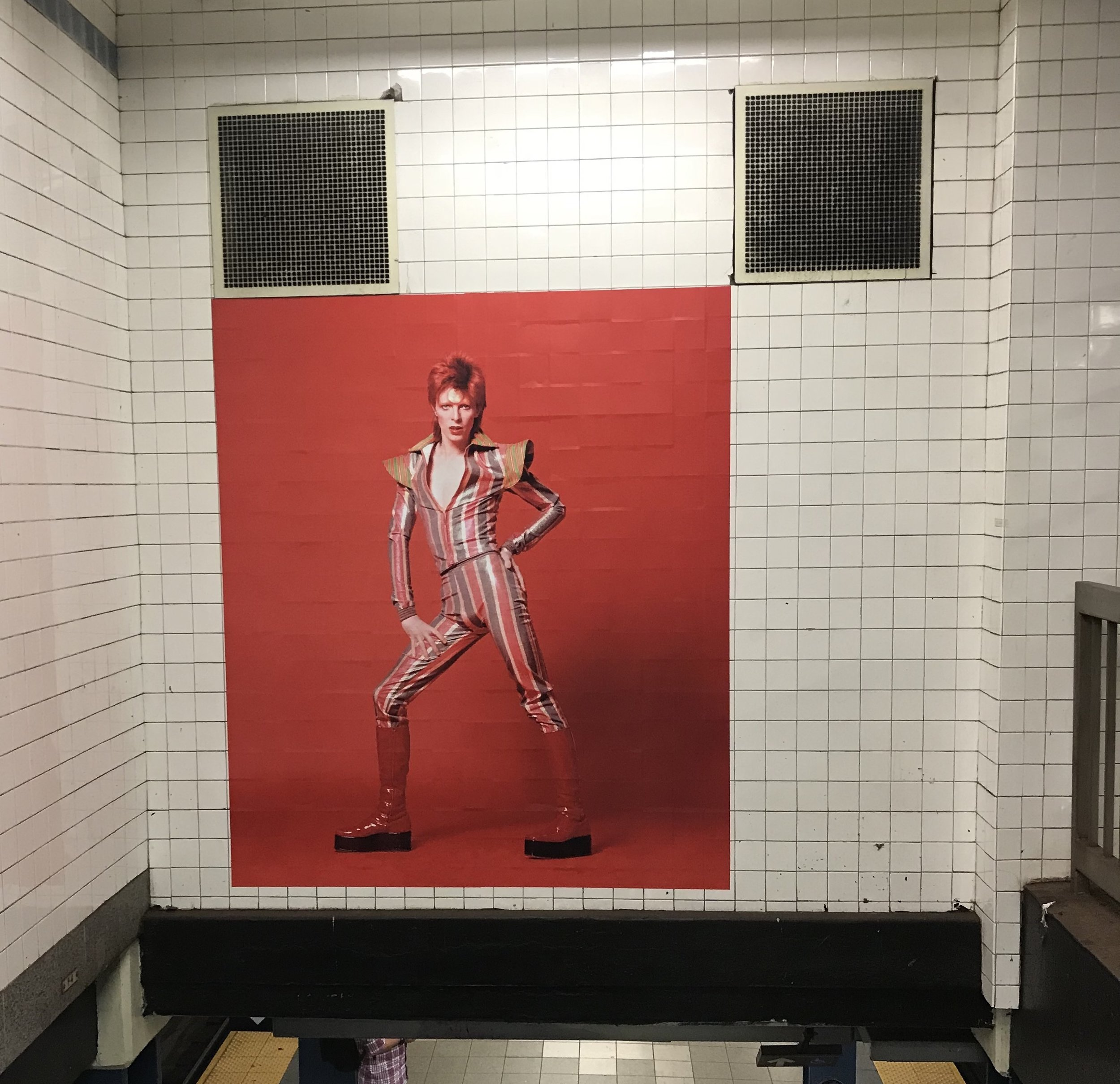 "Hang 'em on my wall… Over the summer of 2018, an art installation dedicated to David Bowie appeared at the Broadway Lafayette subway station, the one closest to his former apartment, as the exhibit ""Bowie Is"" took place at the Brooklyn Museum. Photo by Amanda Schuster."