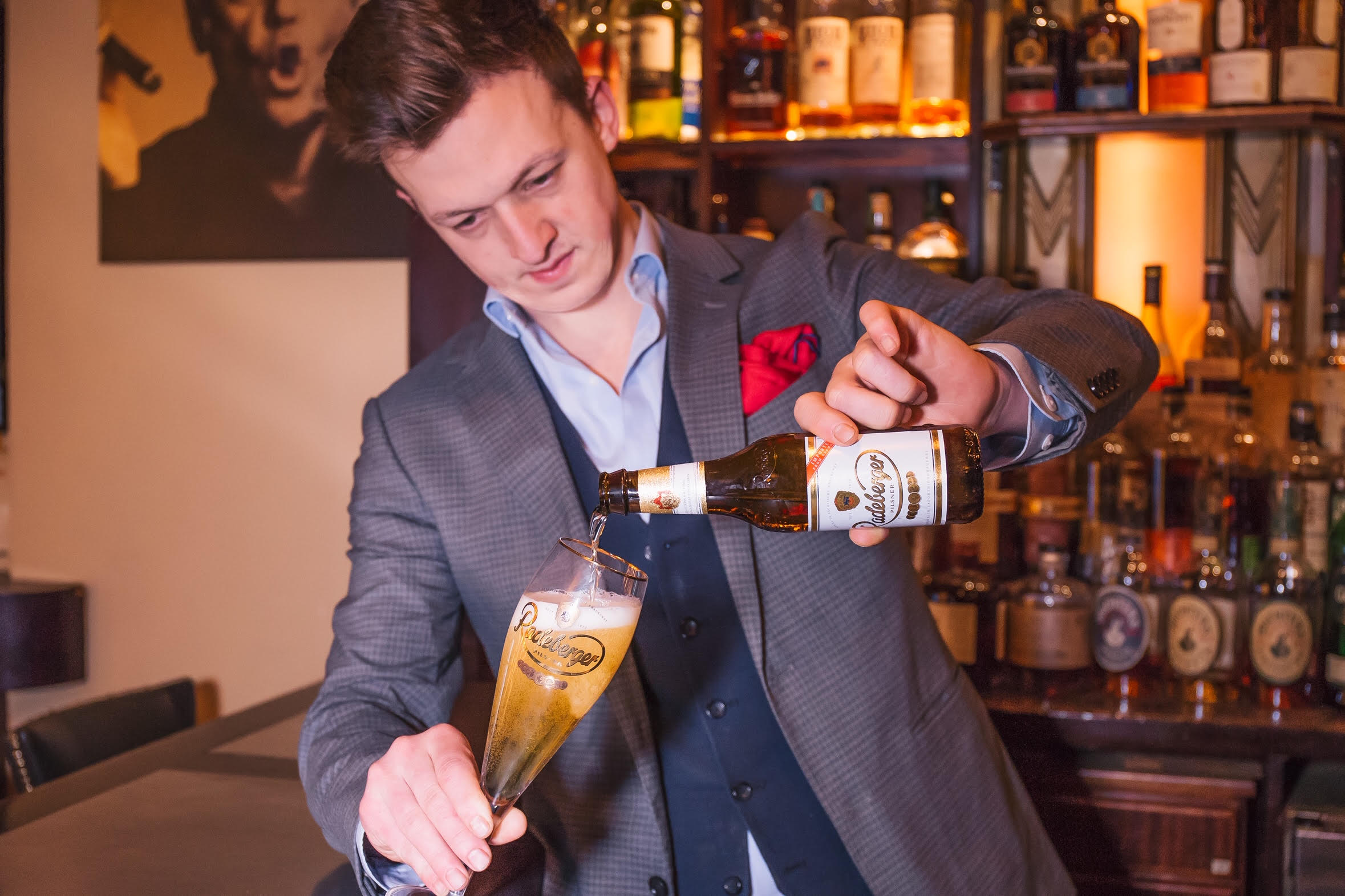 Jared Bailey pours Radeberger at SoHo Cigar Bar, photo by Margaret Pattillo photography