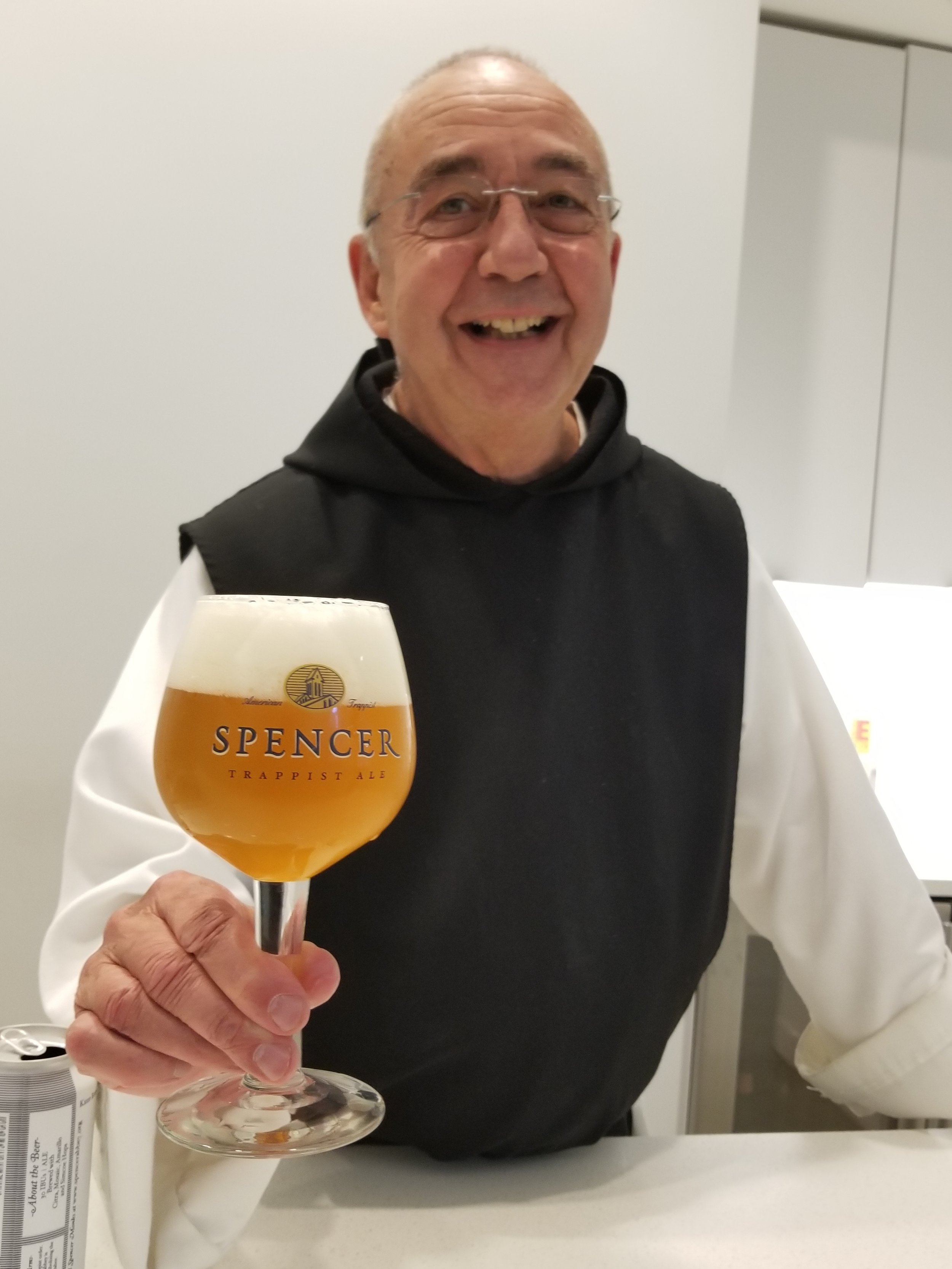 Father Keeley shares a beer