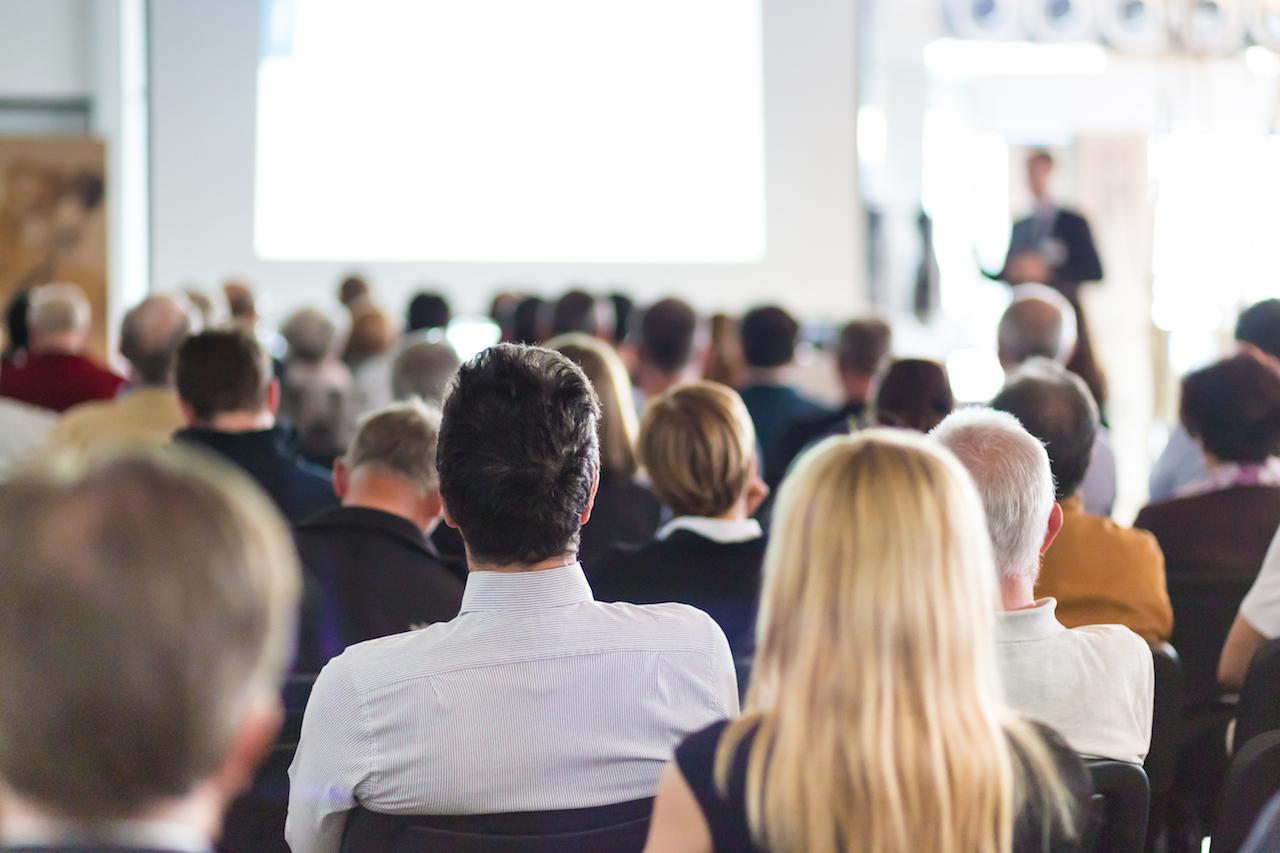 shutterstock_281107127-Speaking-group-audience-copy.jpg