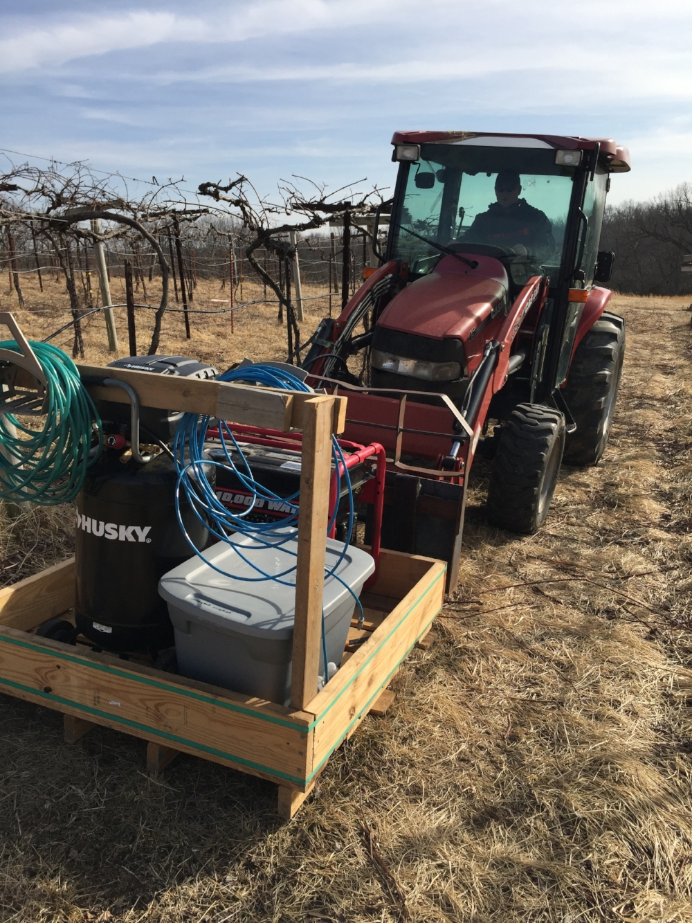 The pruning rig consists of a generator to run the compressor which powers the pruners.