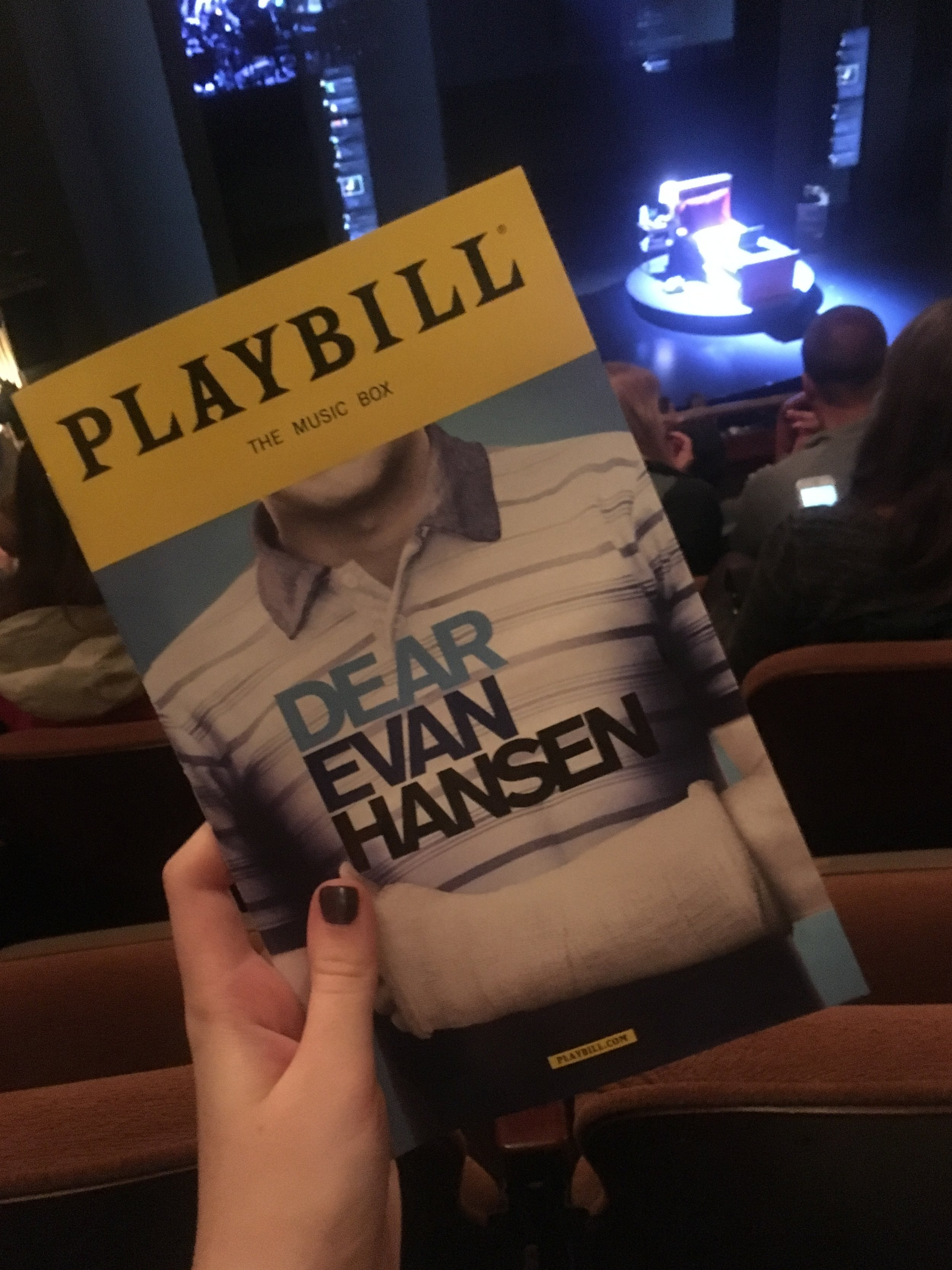 Eleanore J. ('19) takes a quick photo of her Playbill before the show.