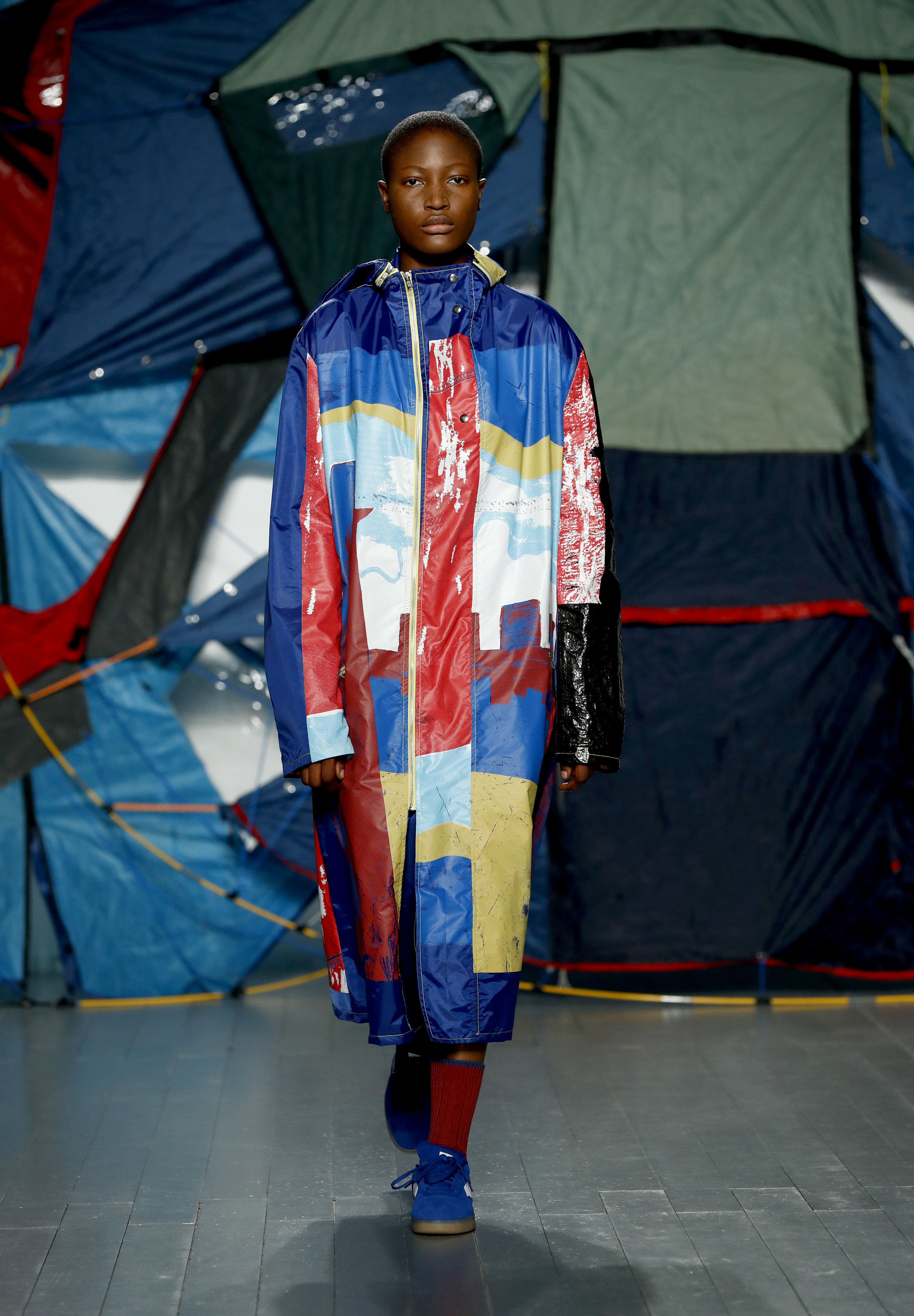 LONDON, ENGLAND - FEBRUARY 19:  A model walks the runway at the Bethany Williams show during London Fashion Week February 2019 at the BFC Show Space on February 19, 2019 in London, England. (Photo by John Phillips/BFC/Getty Images)
