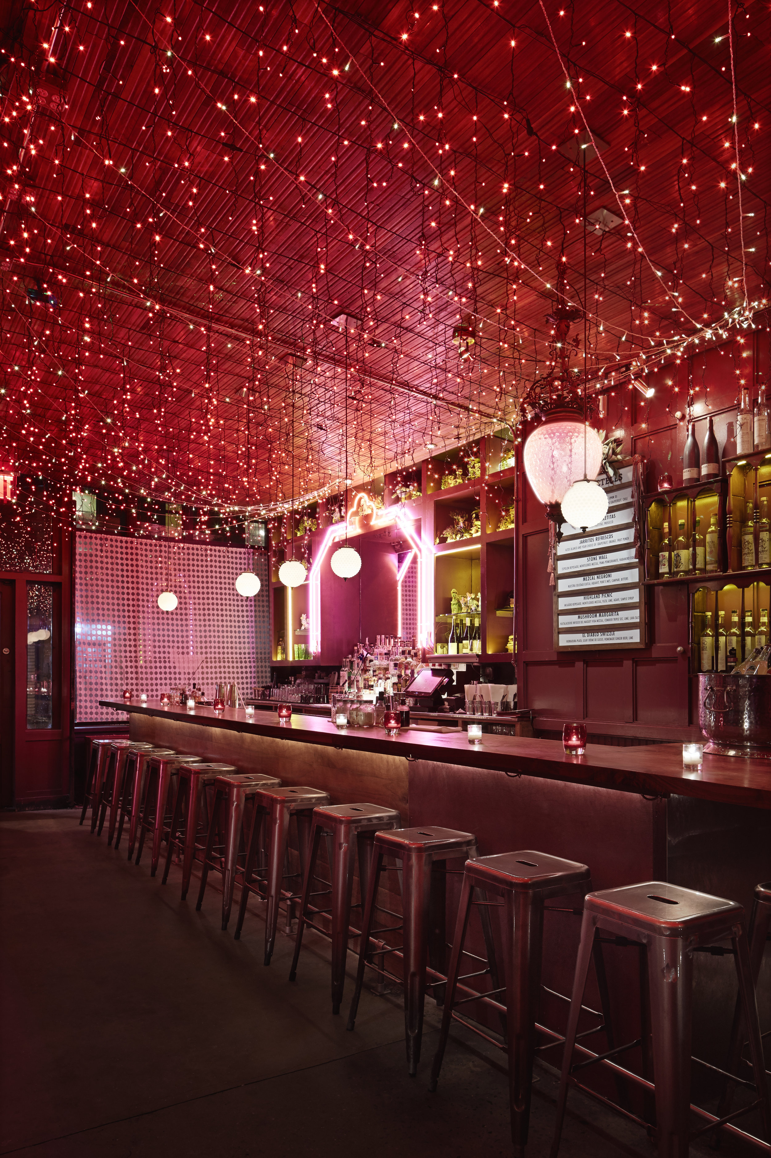 bar with red twinkle lights