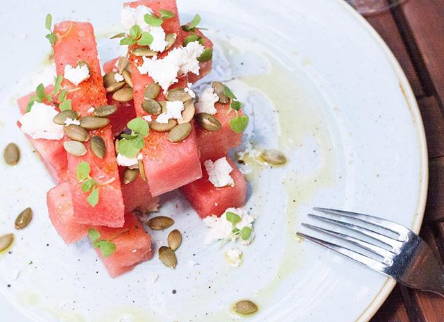 Seasonal favorites, like our watermelon & feta salad, are best savored on the terrace 🍉
