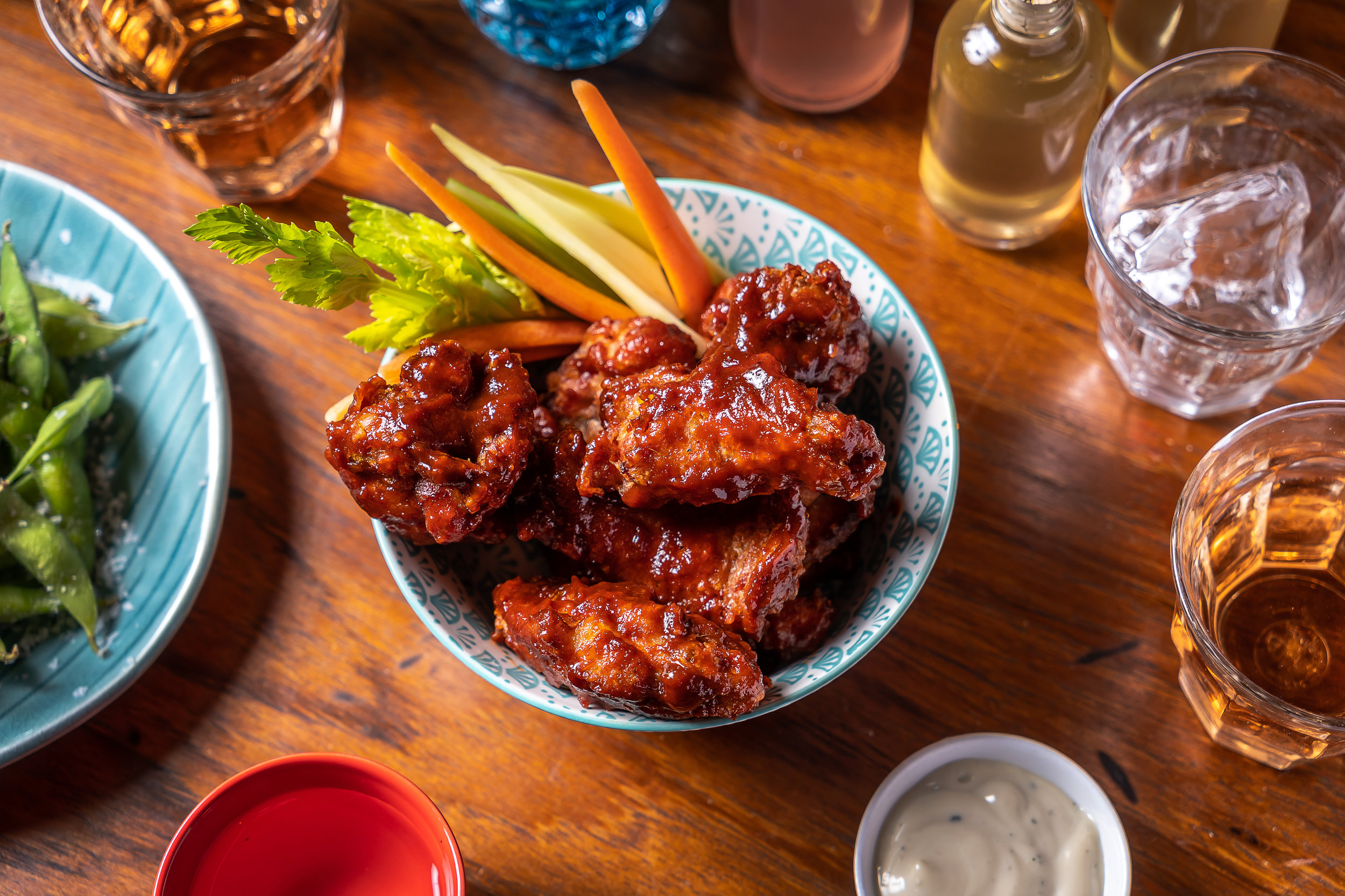 crispy chicken wings in a bowl with pickled vegetables