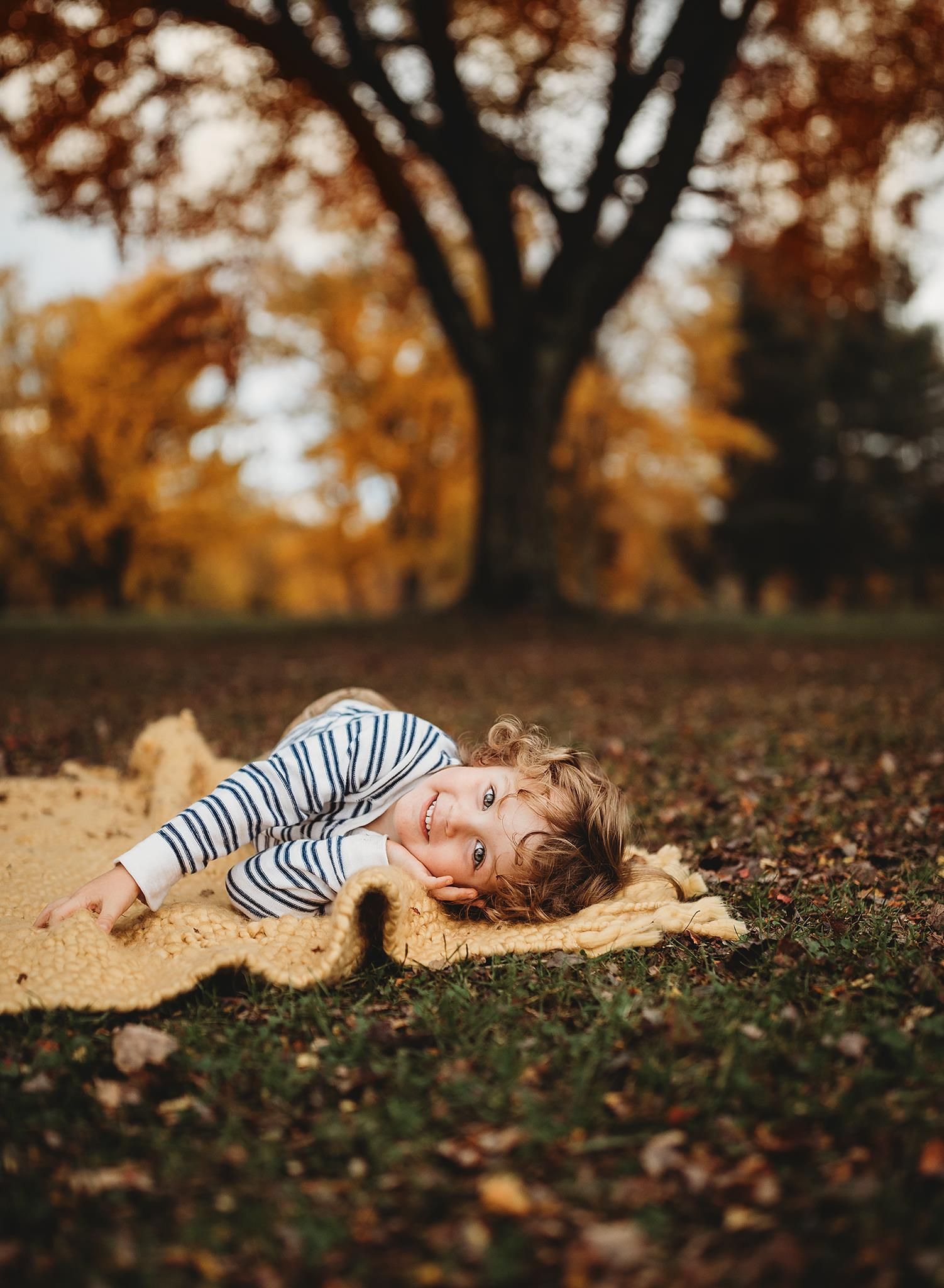 This is currently one of my favorite images of my son. Initially I posed him on the blanket in a way that I felt would work best. Never one to make my life easy, this guy started rolling around all over the place. Somehow I managed to capture this, and I love it.