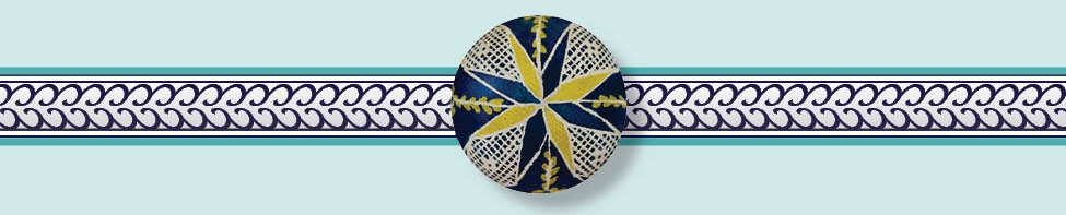 The top view of an Ukrainian Easter egg,traditional known as a  pysanka,  featuring green as the symbol of abundance.