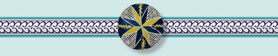 This top view of an Ukrainian Easter egg, traditionally known as a  pysanka, features the star symbol representing Omnipresence.