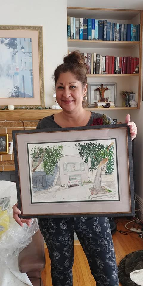 Mallory at home with a sketch of her home