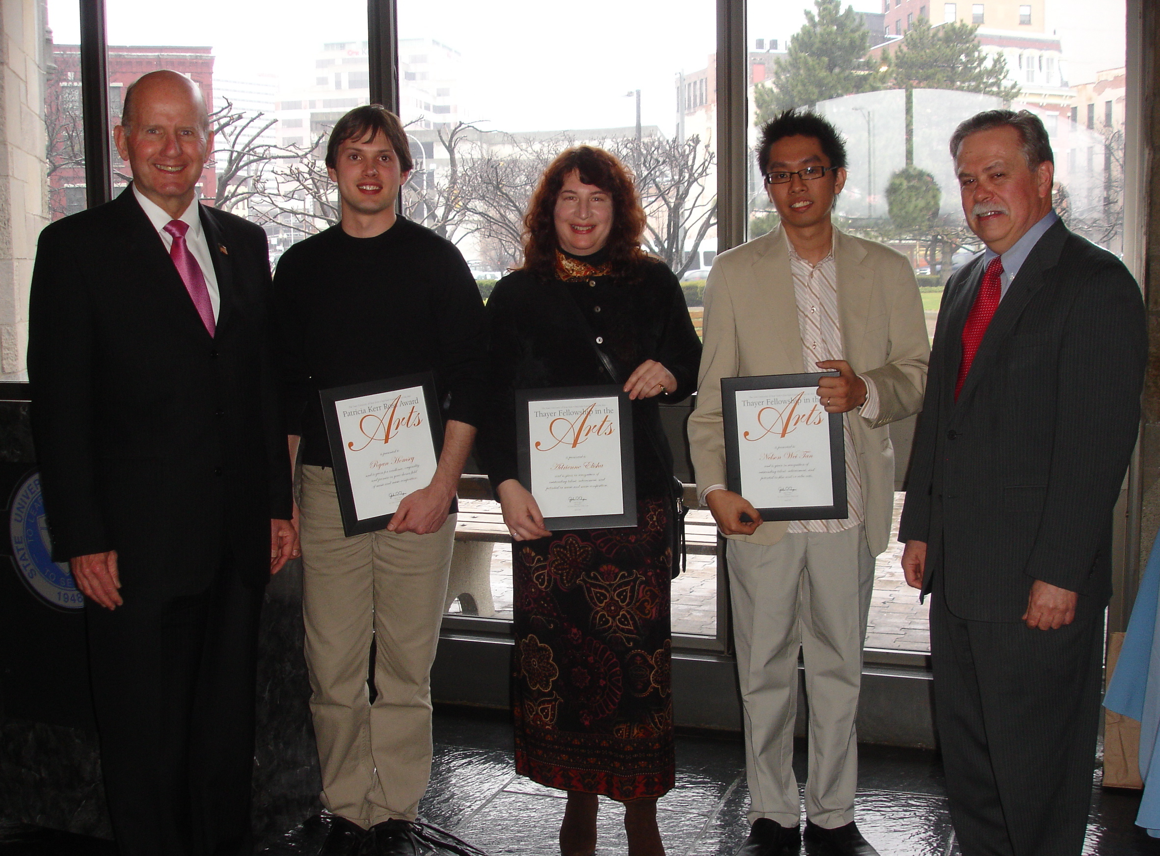 Awardees Ryan Homsey (music), Adrienne Elisha (music), and Nelson Wei Tan (film/video) receiving the Patricia Kerr Ross Award for the Arts from the State University of New York