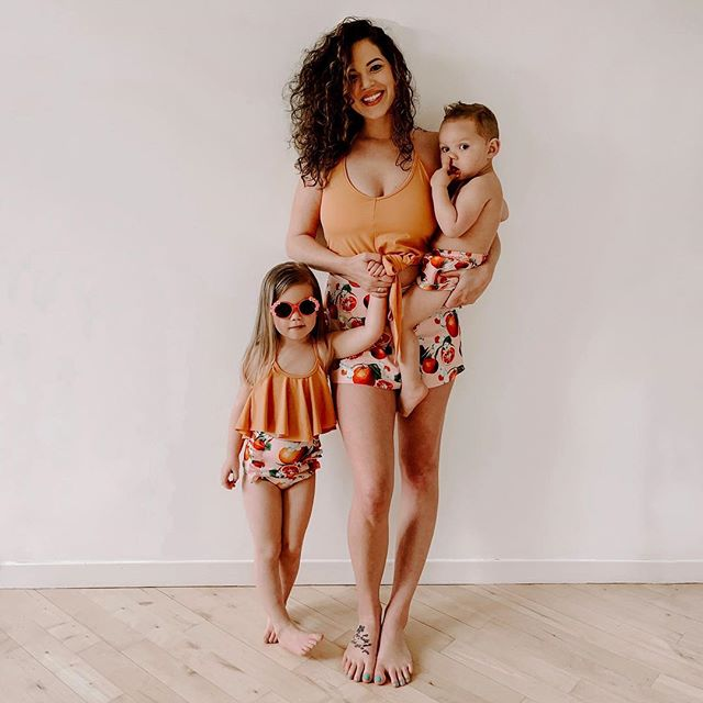 """ANYWAYS THEO. Theo screamed """"matttchinng"""" and Kaia told me she wants to dress the same for life. Really hoping Instagram sticks around forever so we can revisit these statements when they're teenagers. 🍊🍋 swimsuits from @kortnijeane."""