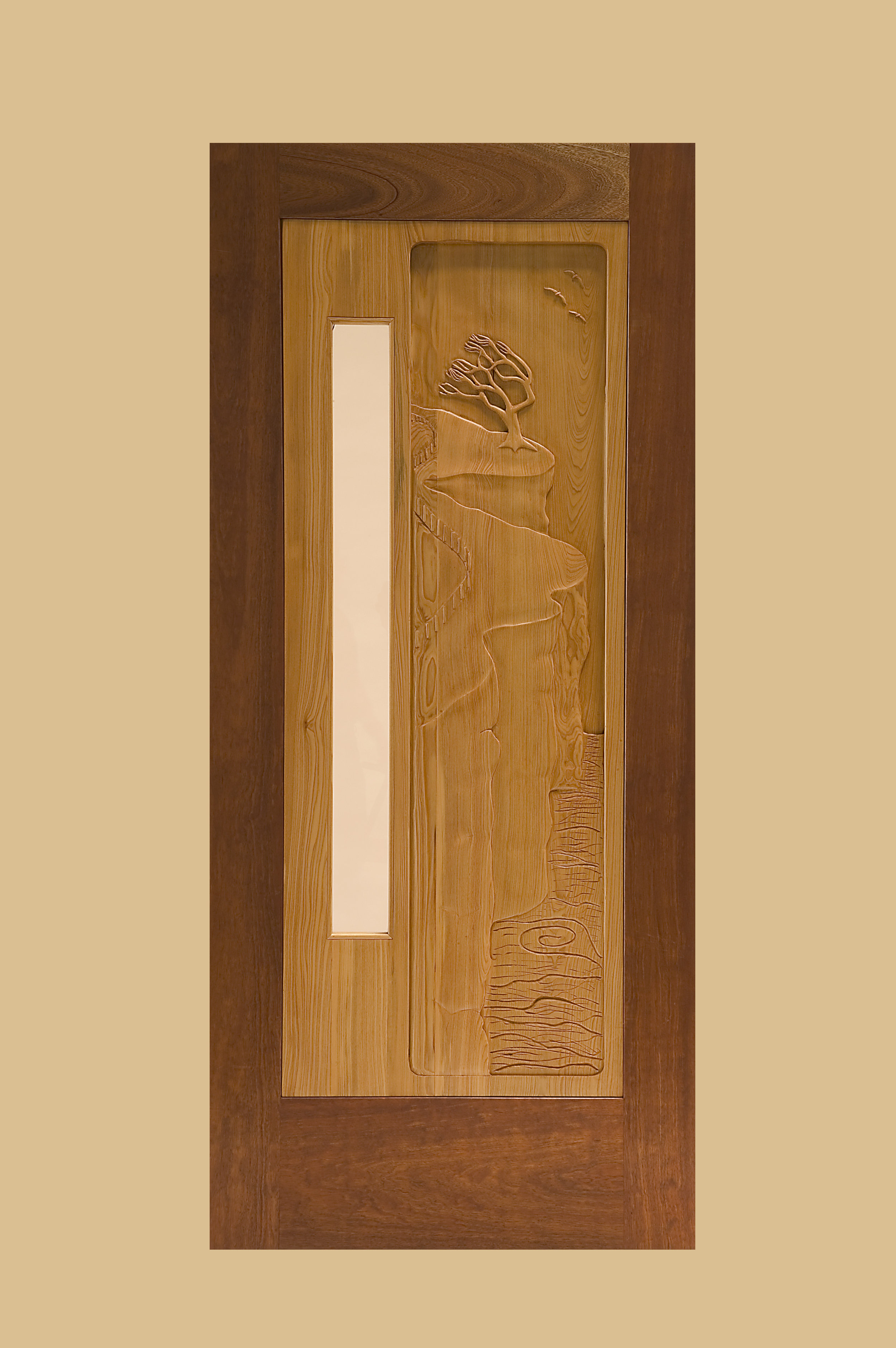 Entry Door, Mahogany with Carved Cypress Panel and Beveled Glass Lite.