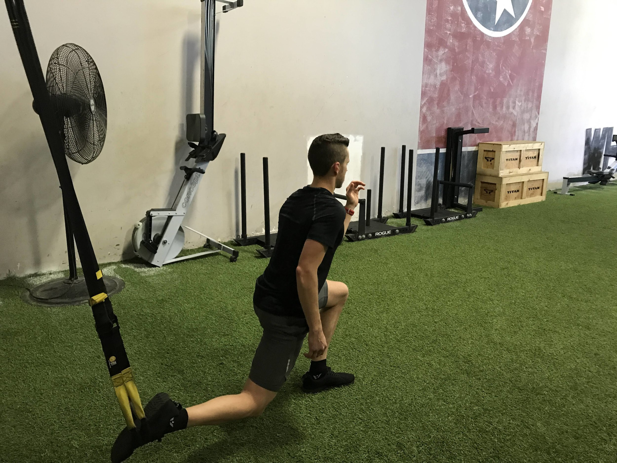 TRX is great cross training and sports injury rehab. Using TRX here on a runner for unilateral quad/glute strengthening.