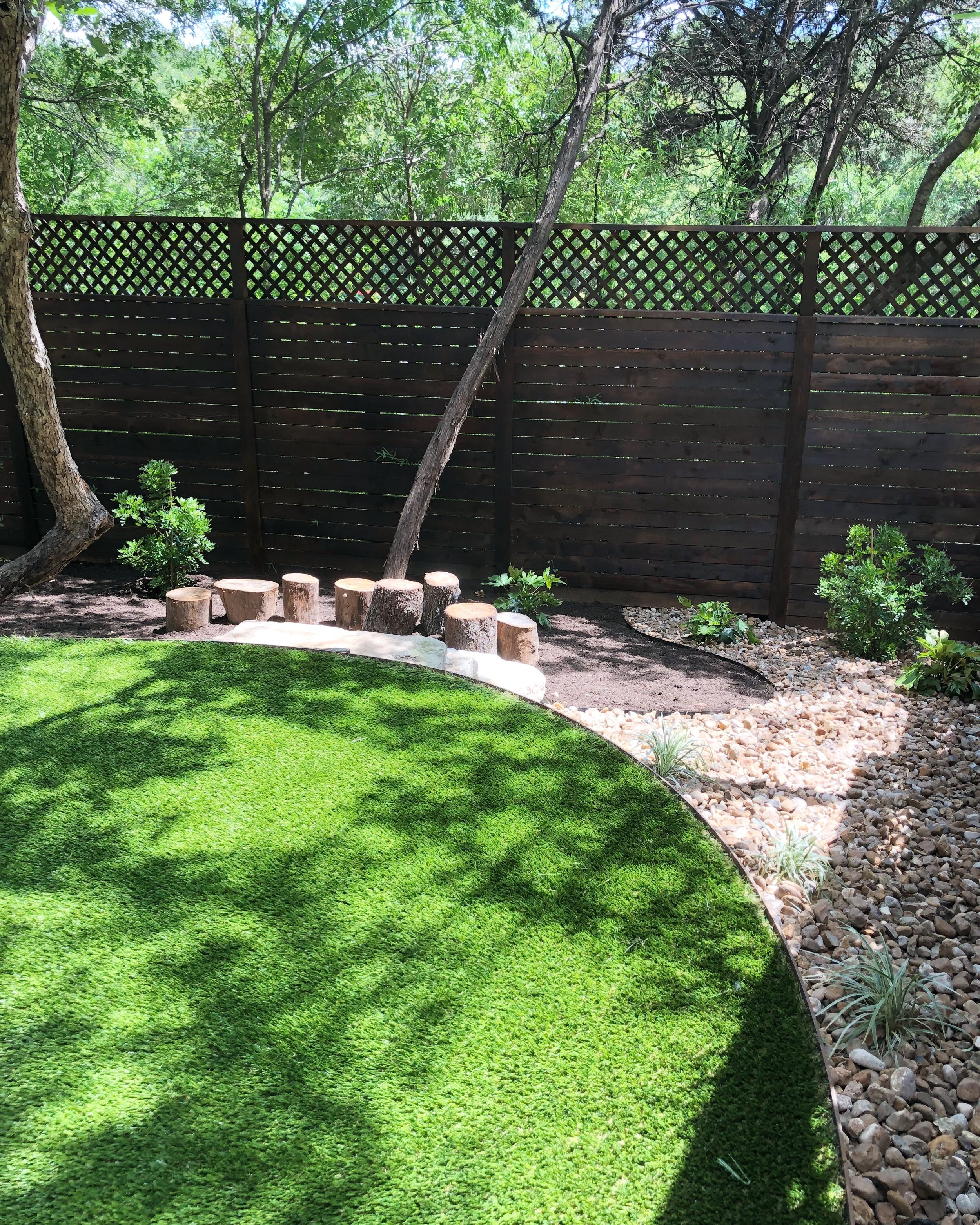 Shaded-back-yard-artificial-turf-landscape-design-play-scape