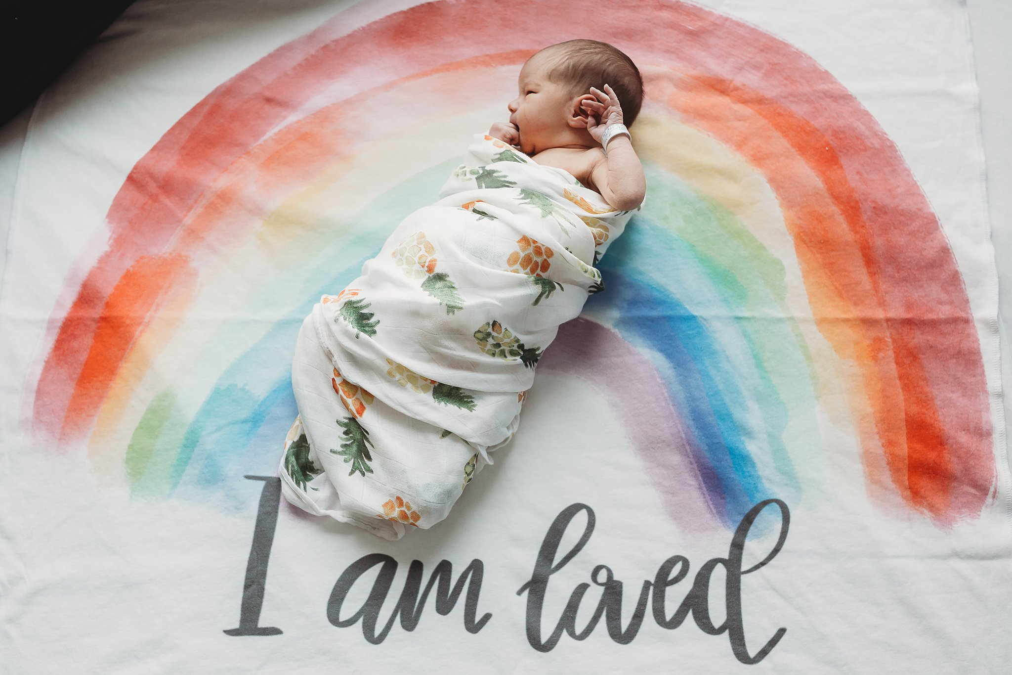 """Rainbow """"I Am Loved"""" Blanket by Little & Luxe. You can find it  here ."""