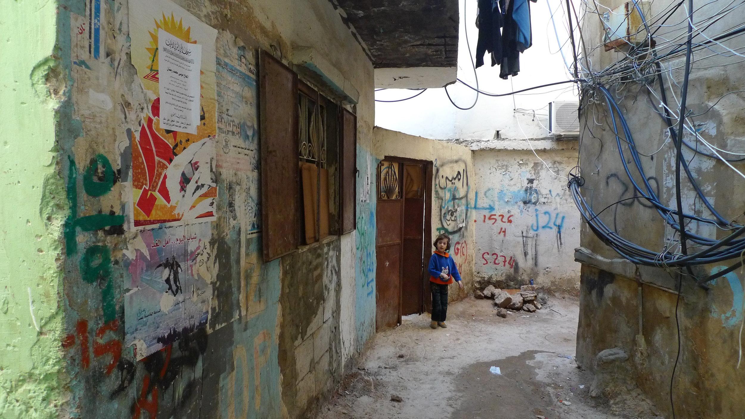 Kid_in_the_refugee_camp_of_Bourj_el-Barajneh_-_Flickr_-_Al_Jazeera_English.jpg