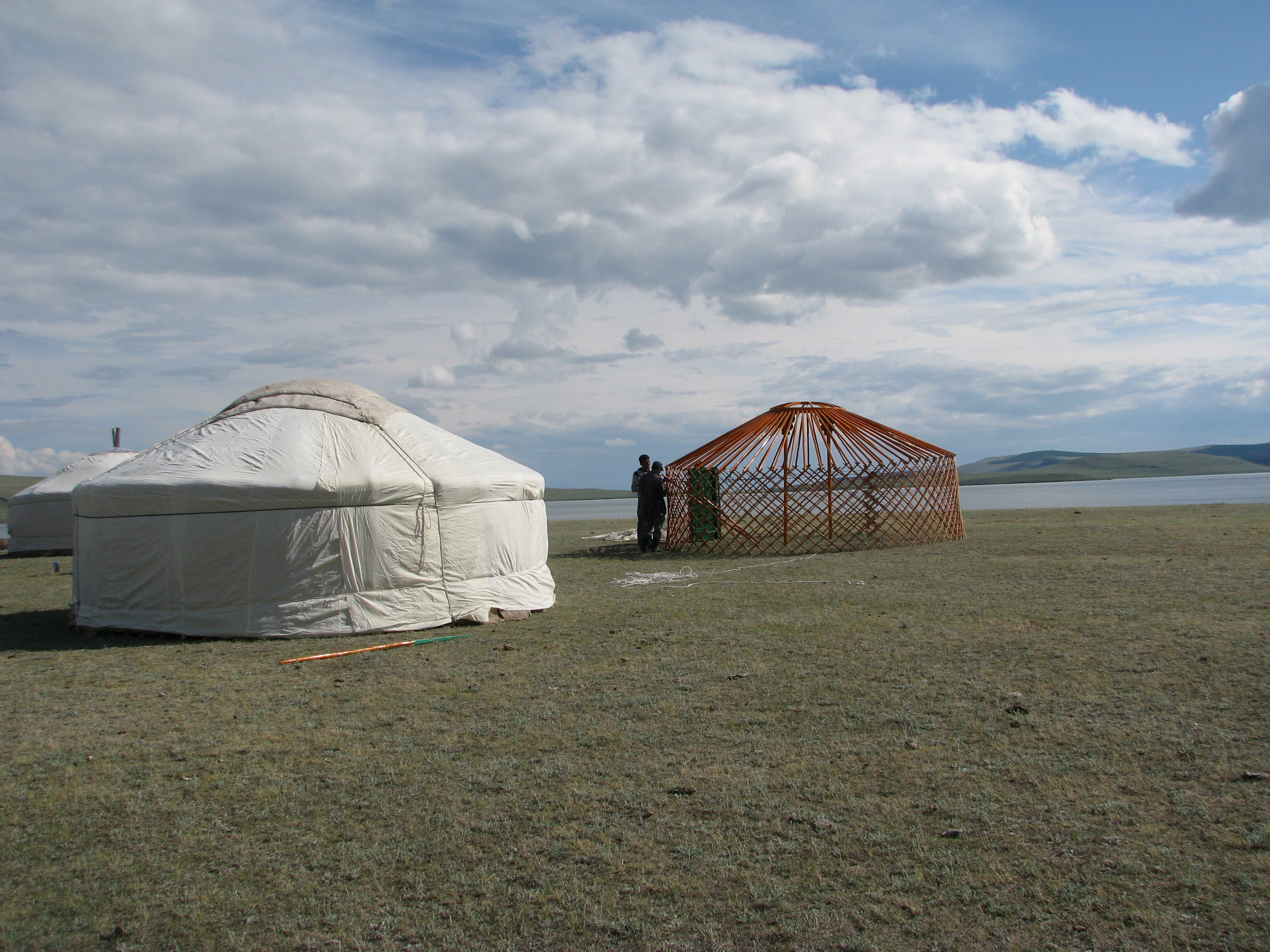 - Two Mongolian gers. In the foreground a recently set up ger, in the background, the 'skeleton' of a ger in the process of being assembled. A wooden inner structure is first covered in a thin cotton covering, then a thick felt layer, and finally a waterproof canvas layer.