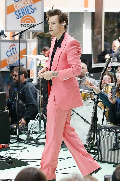 Harry in Edward Sexton. - So, like was saying, black is the great foil to pink. Something Harry Styles Stylist, ace Alistair Mackie, is clearly aware of. The repositioned cool singer songwriter Styles has been strutting in 21inch bottom straight leg bespoke trouser suits by Edward Sexton, worked up with black shirt and boots. I knew charming Harry when he was a boy bringing us Greggs pastries from his Mums shop, just before he got moulded into 1/5th of the biggest selling boy band in history. Writing his own stuff and performing live now in rigs like this, he looks every inch the chic but rebellious authentic rocker. Men wearing pink does channel rebellion, ya see.