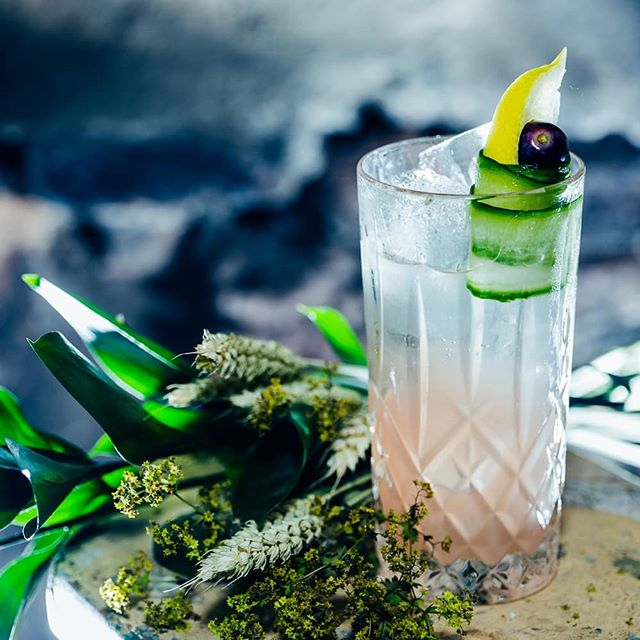 "Another travel inspired libation, from the luscious floral Lowlands of Scotland, where @hendricksgin is usually made, my disciples created ""The Curious Story of the Rose and the Cucumber""  @Hendricksgin, fresh lemon, apple, grapes, mint, elderflower, grapefruit and lavender shrub, soda."
