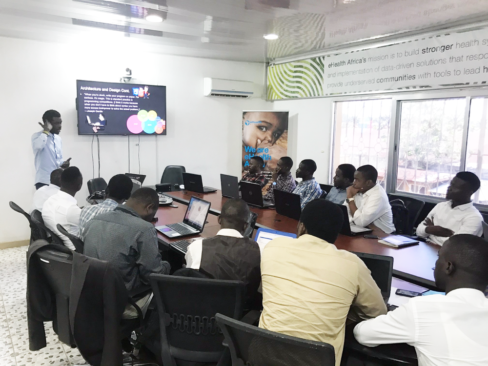 Top Left: Ibrahim Bayoh from the IS team shares developer tips and tricks with the students (Photo: Les De Wit)