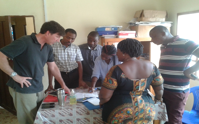 Mentors from the U.S. Centers for Disease Control, Emory University, and eHA help the CHO at Musaia Community Health Center (Koinadugu District) analyze health management information systems data.
