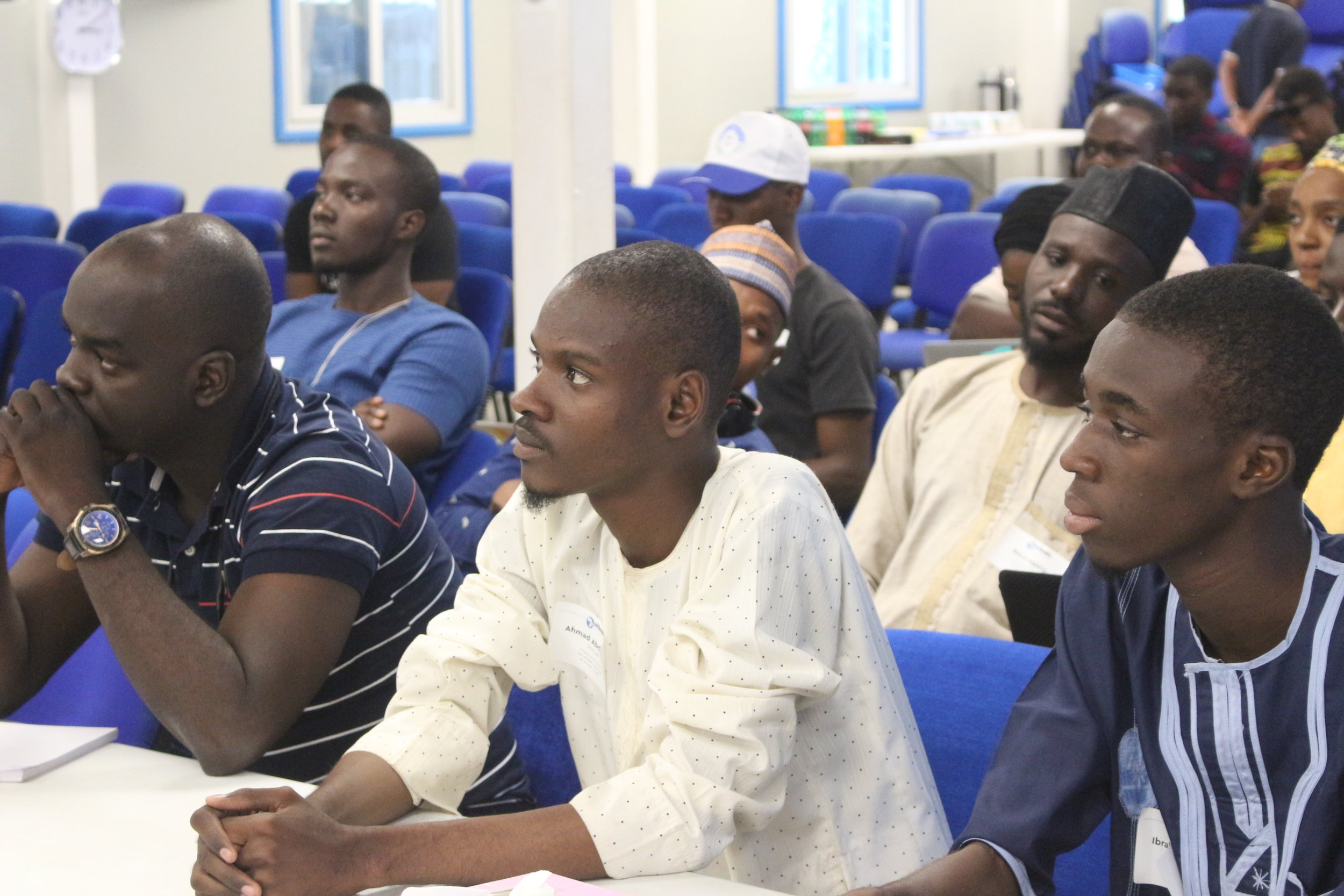 A cross section of the audience listening with rapt attention