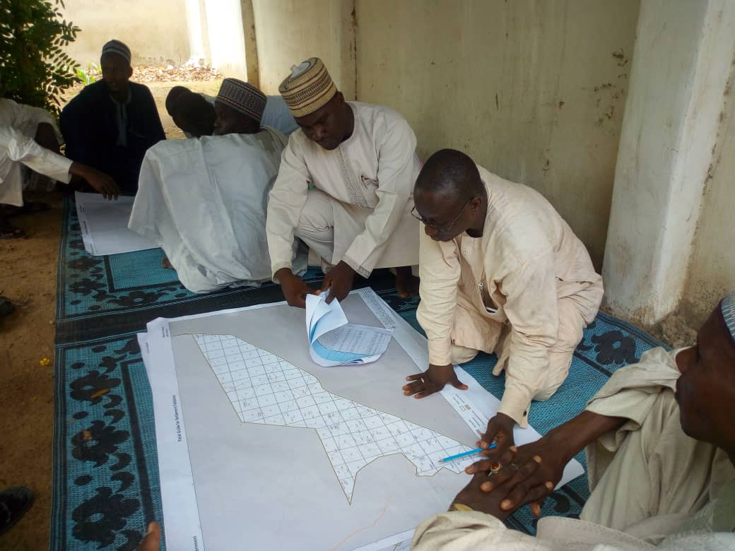 Teams using geo-spatial data to plan immunization activities
