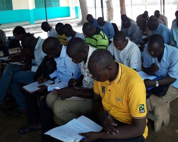 Chad 1st level supports going through pre-test during the transition training in Bokoro, Chad