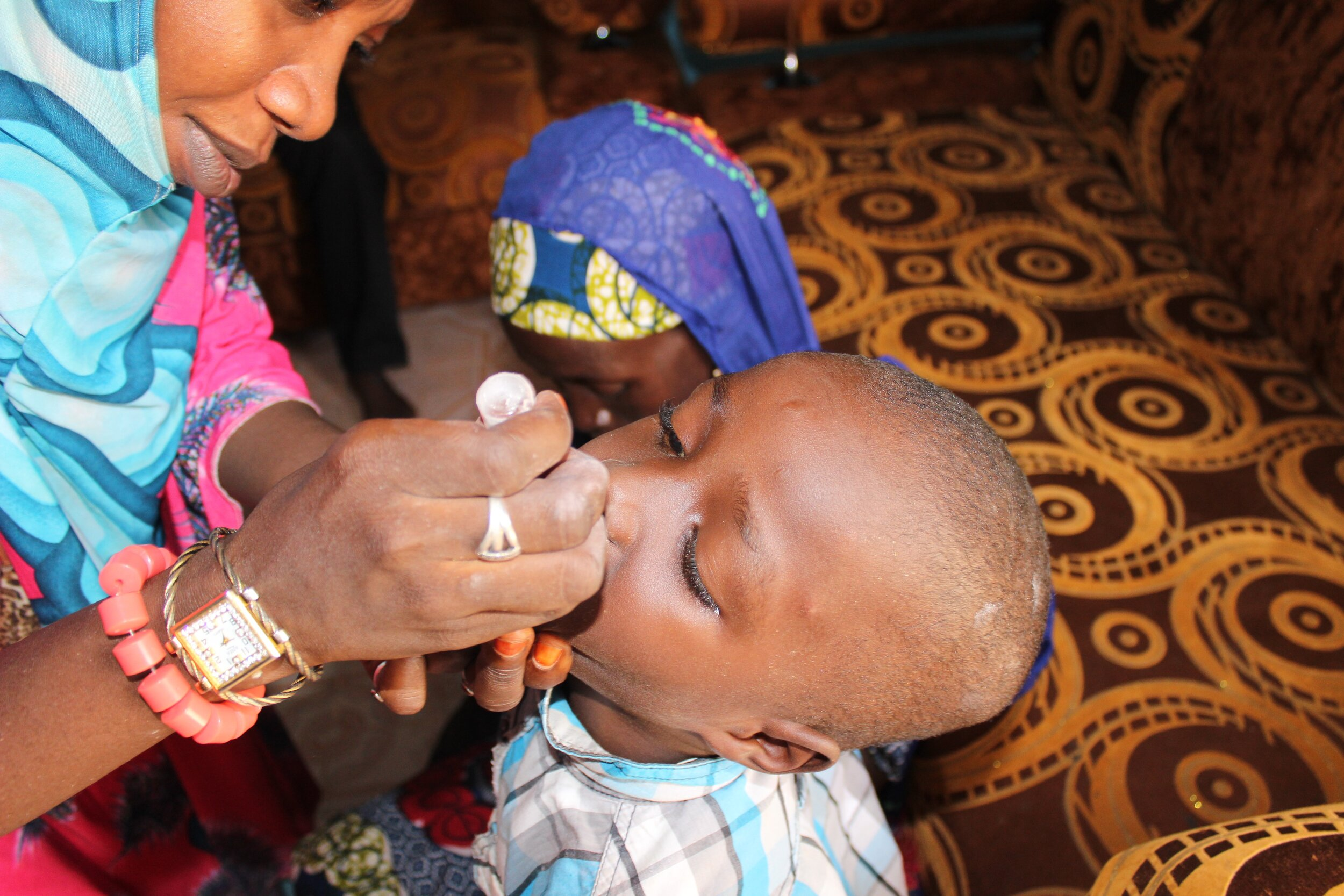 A child receiving the Oral Polio Vaccine