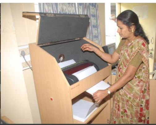 A basic braille printer which can print one sheet in 5 mins and costs 3-4 lakh rupees ($4500-5500)