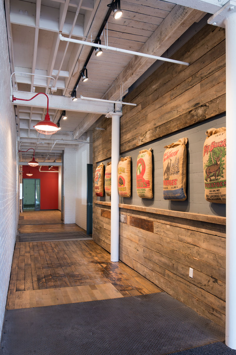 Main floor entry hallway.The design used vintage seed bags once manufactured on site.