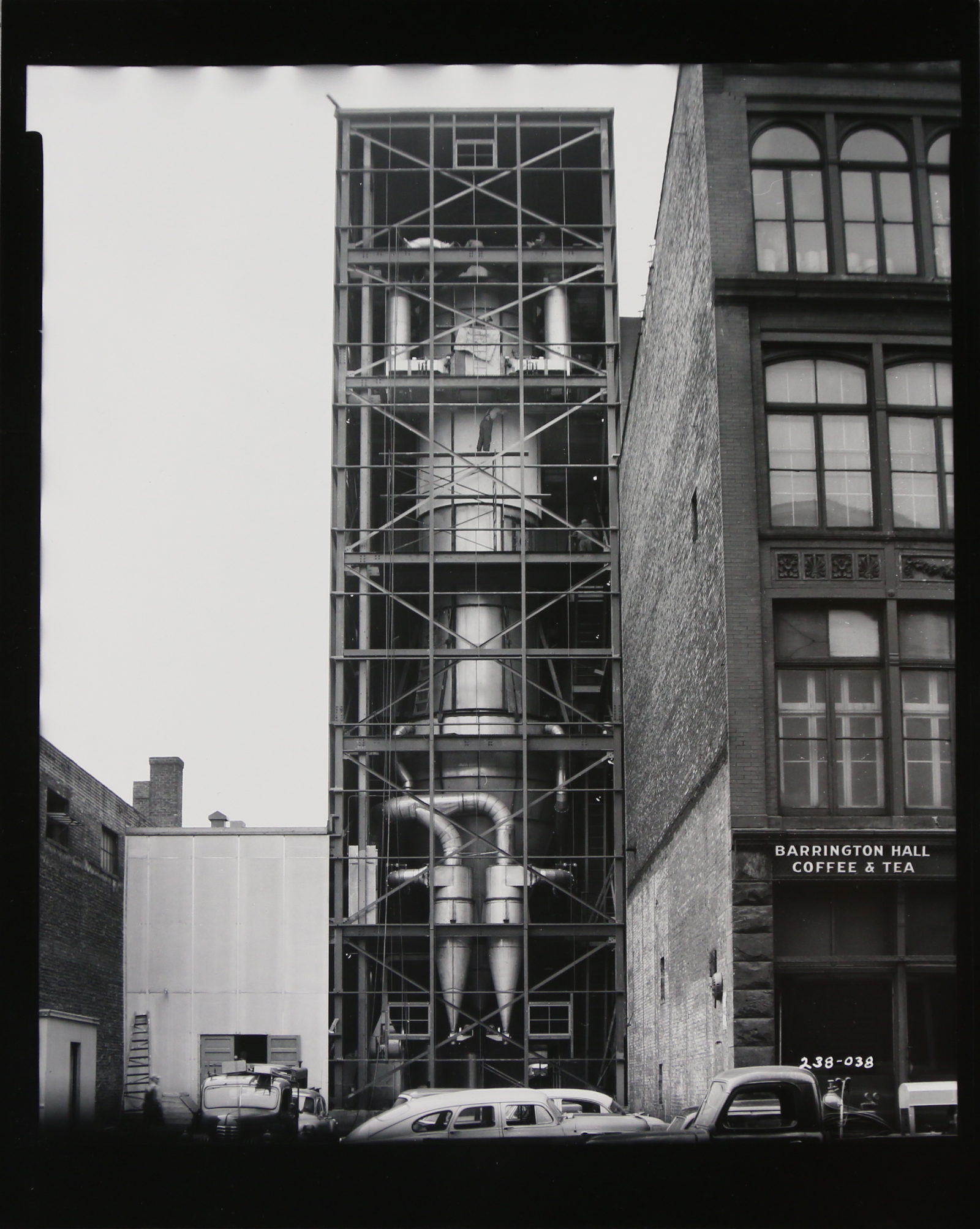 Circa 1917, the Baker Importing Company added a massive grinder to the buildings exterior to produce Barrington Hall Soluble Coffee.