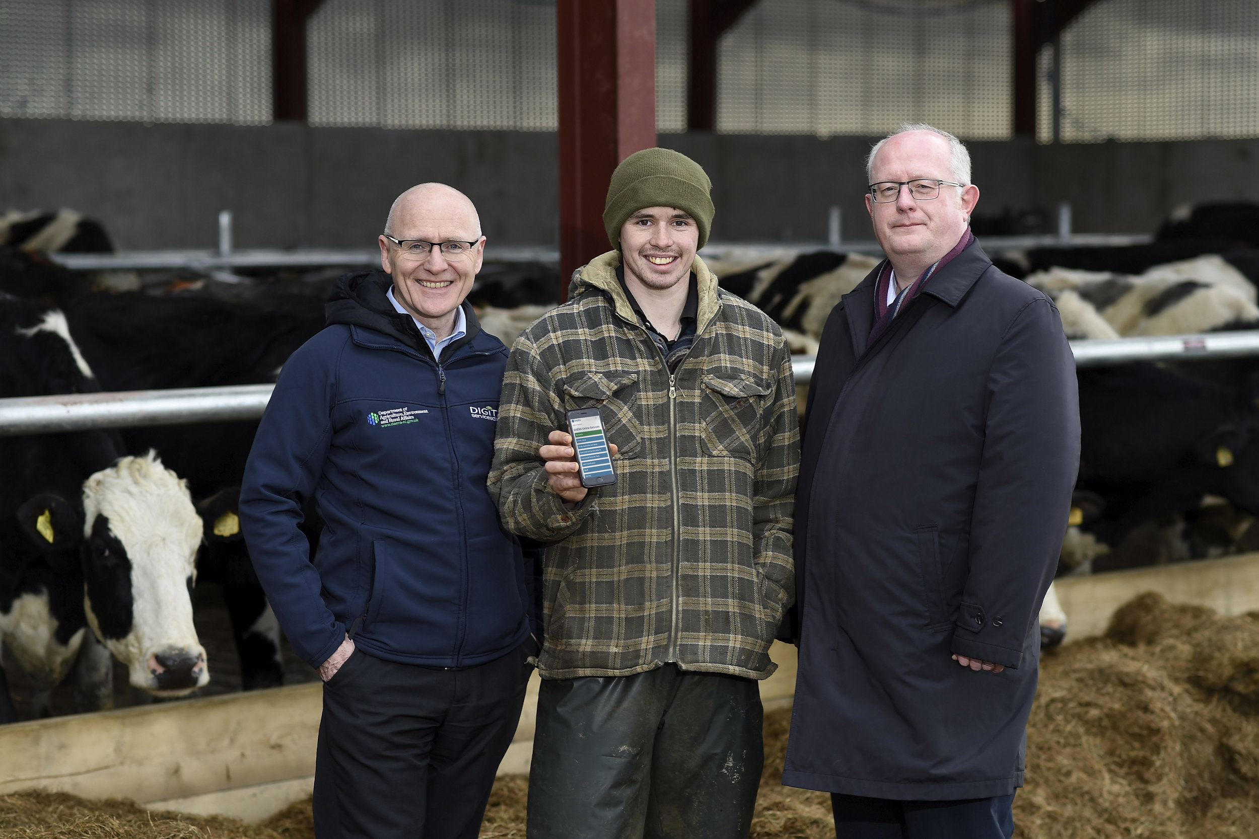 (L-R) Gerry Hackett, Digital Services Division at DAERA with Dale Farm dairy farmer James Lindsay and Neil McKeown, Neueda Head of Consulting.