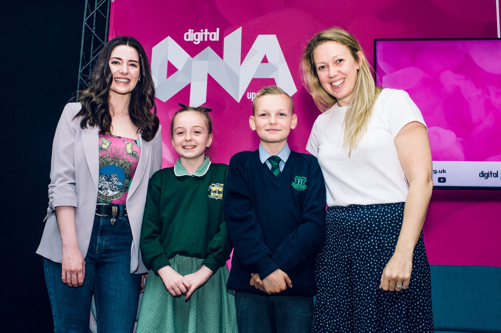Pictured L-R are Youtuber and Keynote Speaker at Digital DNA Melanie Murphy; Code Club graduates Kelsie Flynn, St Malachys PS and Rocco Audley, Blythefield PS with Lisa Sweeney, Neueda