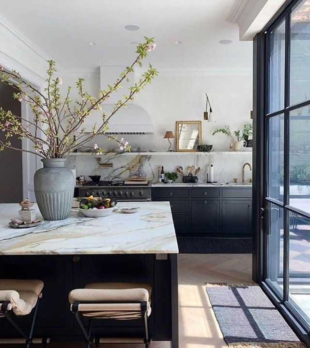 Recipe for the perfect kitchen: Black shelving, white marble, and a whole lot of sunshine! . . . . . #upscaleinteriors #upscaleinteriorsAG #designthelifeyoulove #dekor #germaninteriorbloggers #zuhause #dekoration #inneneinrichtung #architekturbüro #interiør #interiör #interiordesigner #interiorstyle #interiorinspo #interiorandhome #interior4all #homestyling #interiorforinspo #passion4interior #interiorlove #interior123 #interiorlovers #interiorforyou #interiorideas #instahome #interiordesignideas #passionforinterior #dreaminterior #interiorgoals | via @altforlivingDesign by @eyeswoon) #ALTforLiving