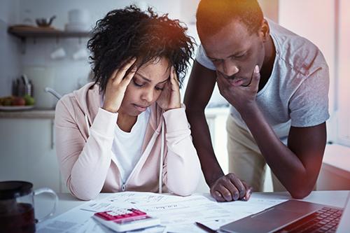 Recharacterizations - Young couple studying taxes RECTANGLE.jpeg