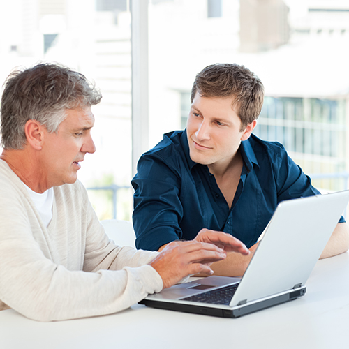 IRA Compliance Blunders - Two guys at laptop - SQUARE.jpg