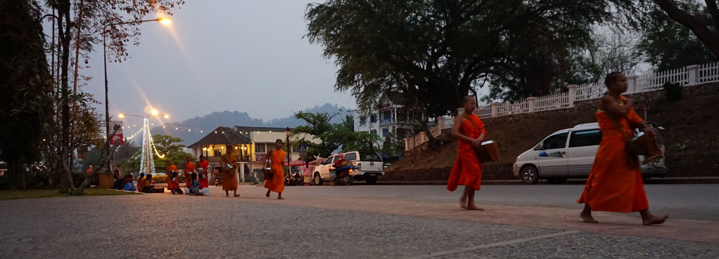 Young monks collecting alms at sunrise