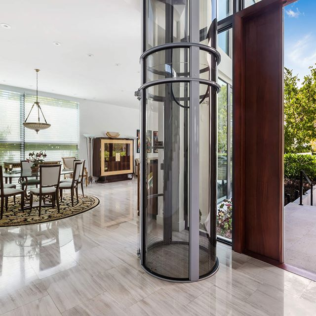 We love when a home can beautifully blend function with design. This glass #passengerelevator at our Key Biscayne listing eliminates stairs for a beloved grandmother. Details on this 2015 constructed tri-level home in bio! #functionaldesign #keybiscayne #miamihomes