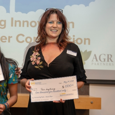 SEA Board Emeritus/Alumna  Niki Peterson  accepts the Food+Ag Innovation Poster & Pitch Competition award on behalf of  Pair Anything .
