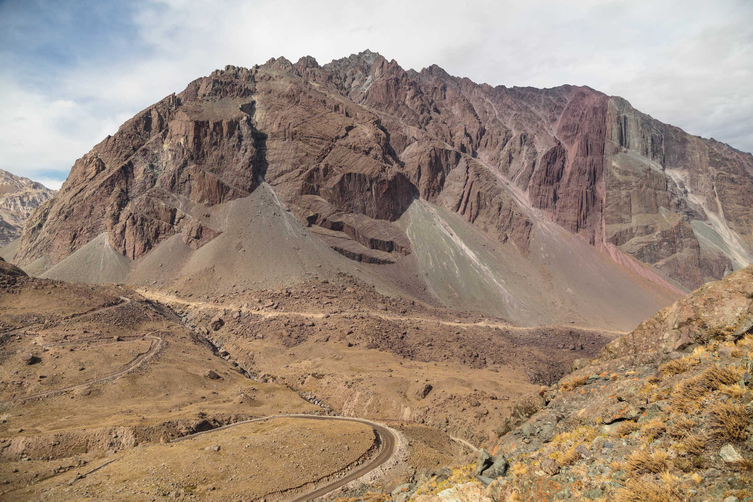 Andes in the Cajón del Maipo. Pictured are stepped failure planes associated with the   Cerro Catedral rockslide   (deposit in foreground).