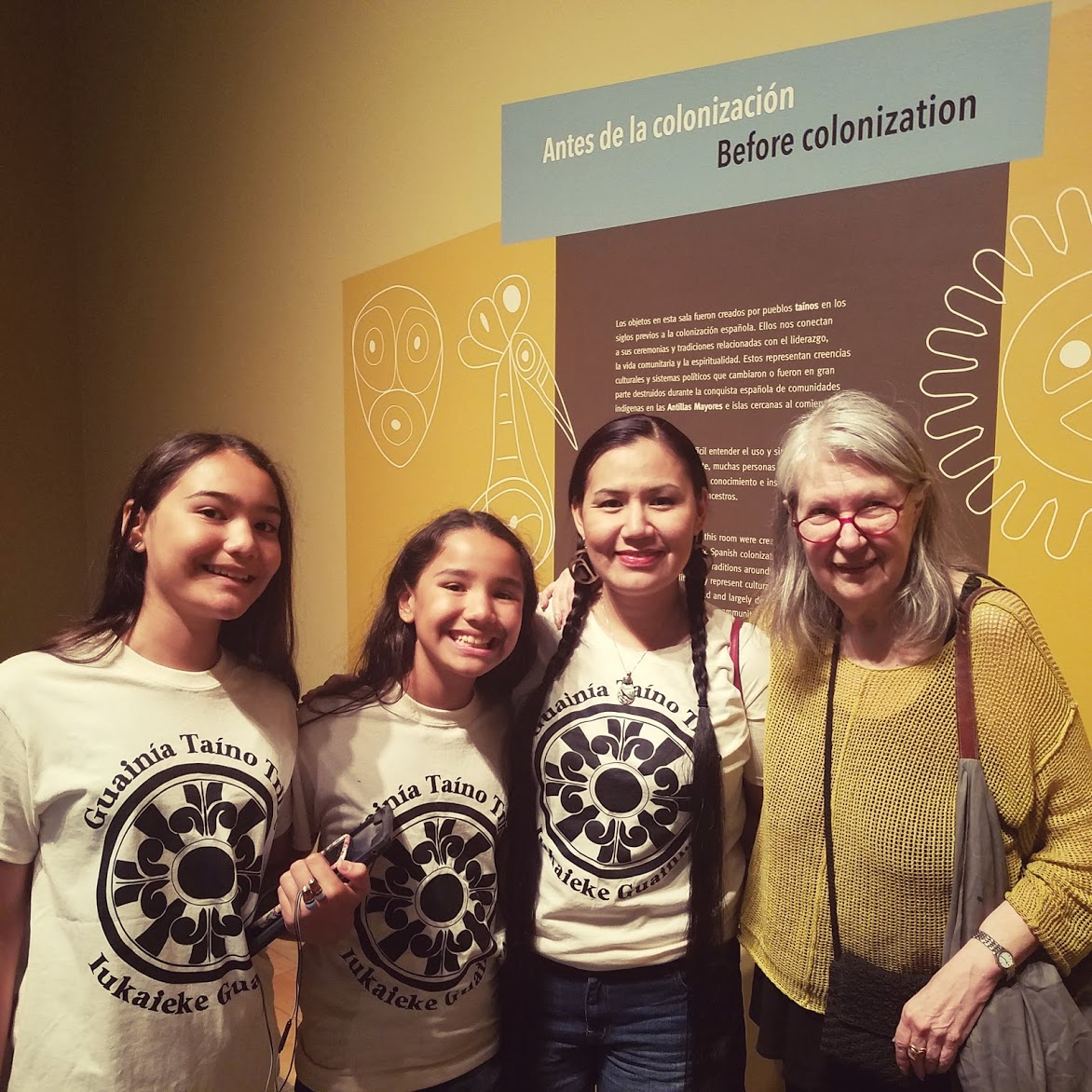 "Pamela Kraft, Tribal Link Foundation's Executive Director (at right) attends the opening of ""Taíno: Native Heritage and Identity in the Caribbean"" at the Smithsonian's National Museum of the American Indian on July 28th, 2018 in New York. In photo (from left): Mainaku, Kayaani, and Joselyn Borrero with Pamela Kraft.  Photo credit: Roberto Múkaro Borrero"