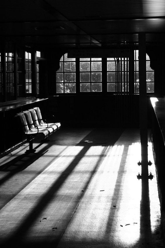 Past Present and Future ... This waiting room represents to me the start of an adventure, what has happened in the past who has been in the room, is anyone going to arrive today and who will arrive in the future.. The light streaming through could indicate that it is such a nice sunny day that people don't wish to use it? or the light thrown on the room reflects the warmth in the room. There are so many different scenarios and your imagination can run riot e.g is it a film set, is it a GP waiting room, a hotel, train station ? so many possibilities... The photographer has blown out parts of the imagine, due to the fact that he probably metered on the ground, given clear distinct lines, however on the metal chairs it is over exposed.