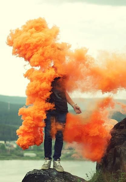 I love the strong ochre colour which develops into orange again a really eye catching vibrant image which is central to the shot with the model perched on the rock and the soft background of the river giving a sense of danger and precariousness the smoke bomb has developed mainly down the left hand side exposing the right arm whilst again hiding the face. It is difficult to have control over where the smoke bomb distributes and to place the model in the correct place and dealing with the elements moving the smoke around.