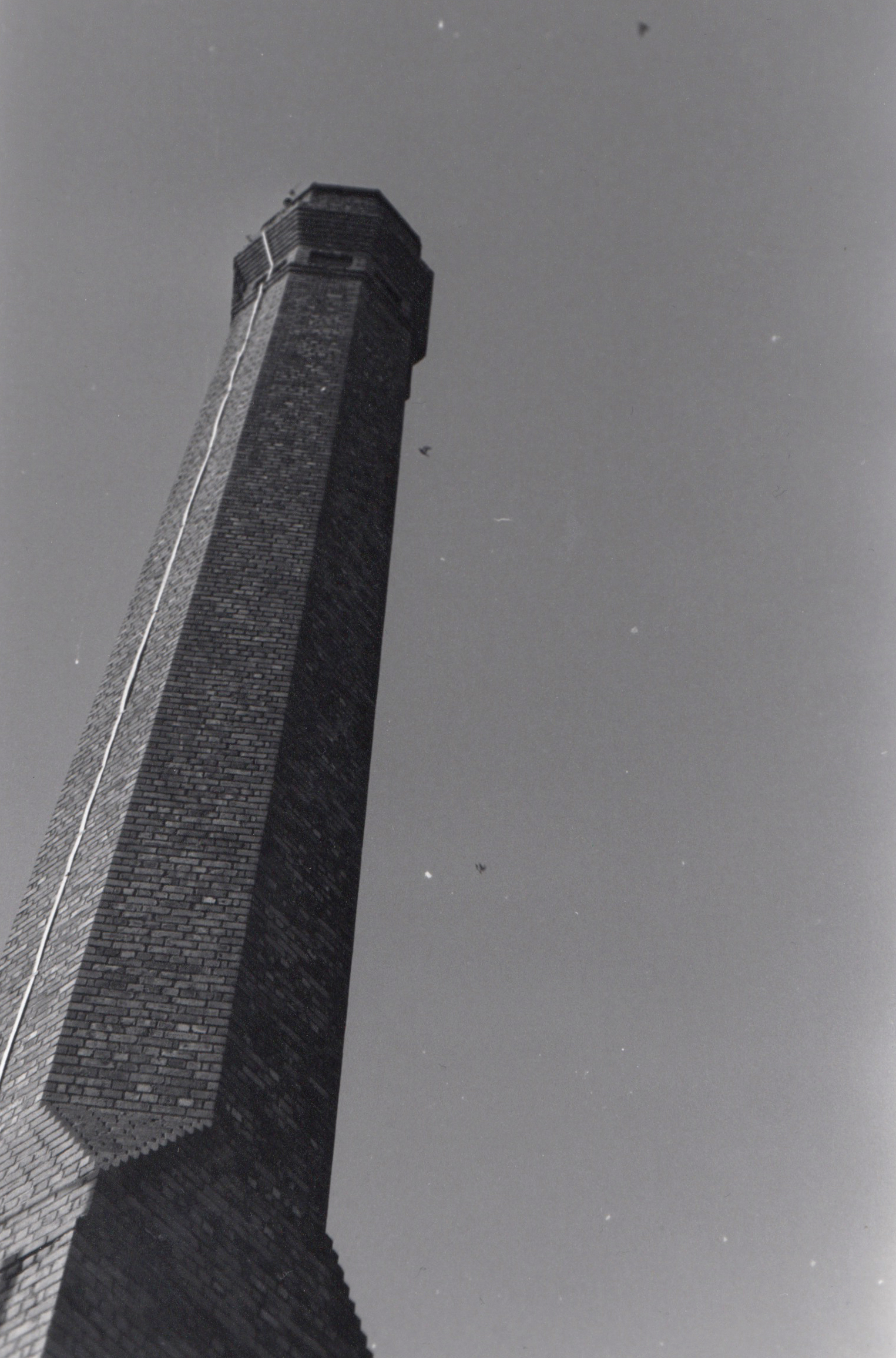 This image is an industrial chimney that was probably in use in the 1980s however it is now abandoned and neglected. I like how I managed to capture the light on the different sections of the chimney and create is sort of a contrast from white to create to black. Sadly whilst I was printing there must have been smudges on the film or on the land that I've created white splodges on to the image. If I could take this image again I would have waited until there were clouds directly above the chimney making it look like it was still active