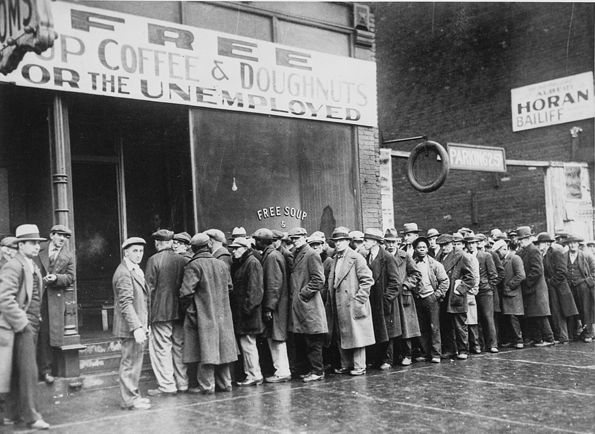dustbowl_unemployed_men_queued_outside_a_depression_soup_kitchen_1931_-_nara.jpg__2000x1457_q85_crop_subsampling-2_upscale.jpg