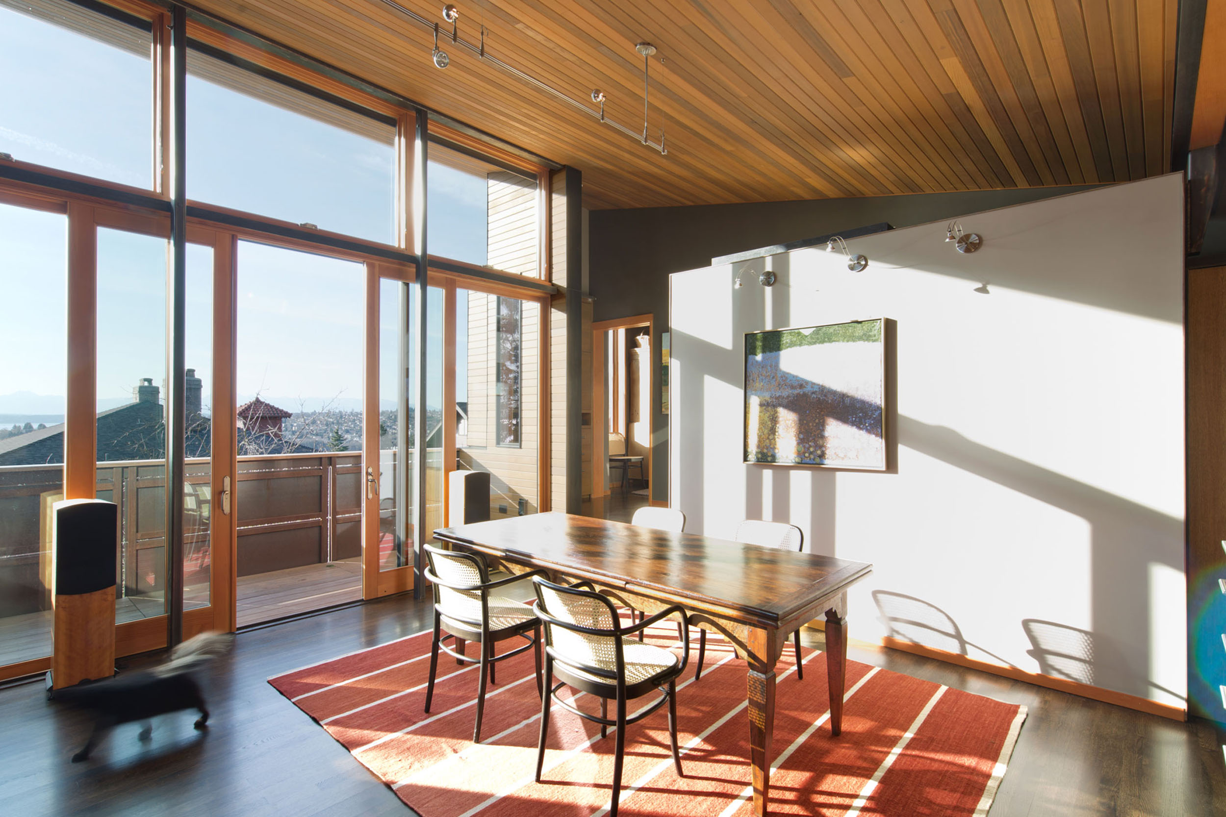 A sun soaked dining room with a view to the mountains beyond.  The simple space, connected to the living room and deck, provides special place for meals alone or with friends.