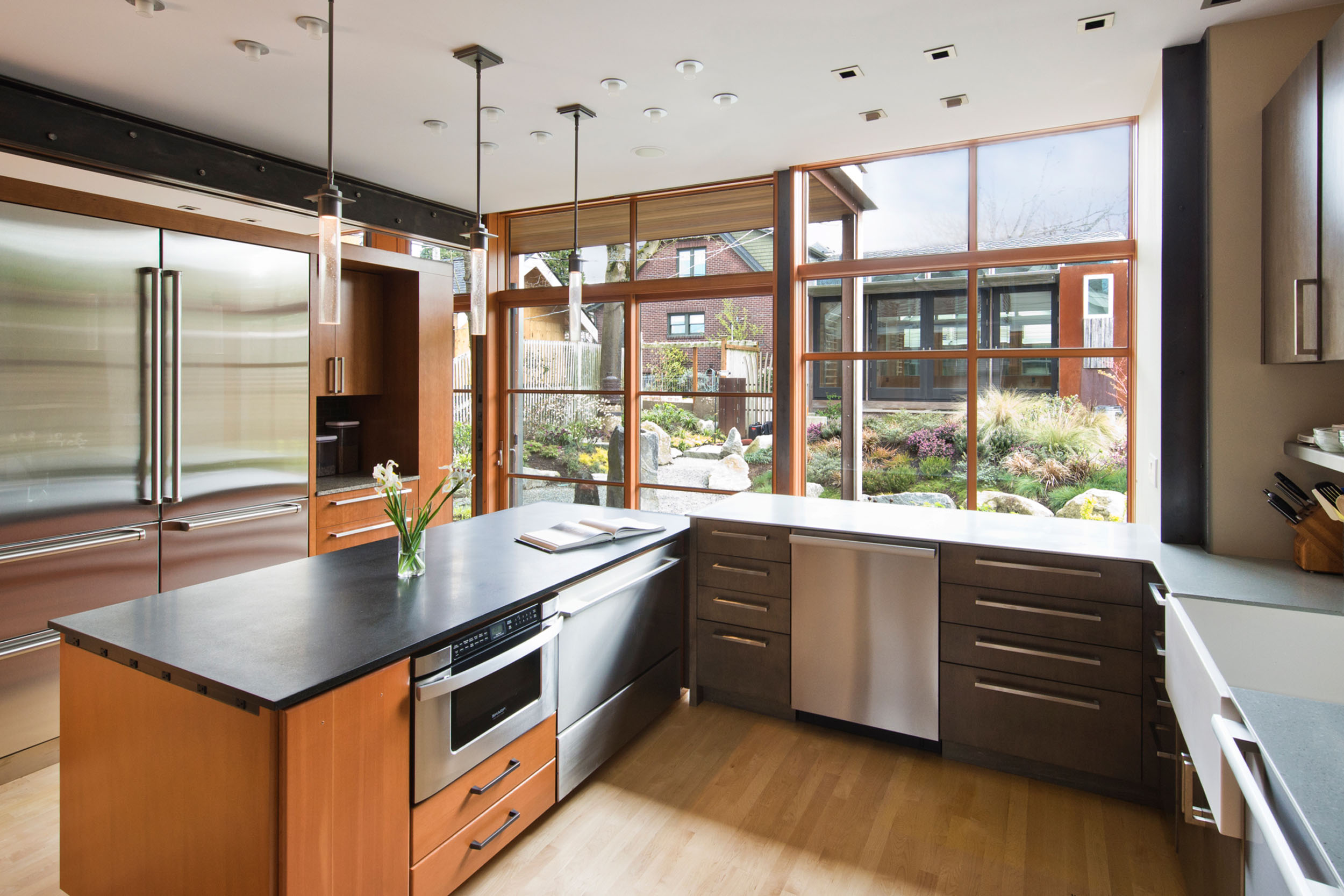 In the Baker's kitchen by Hoke Ley, the layout functions well for entertaining guests while actively cooking.