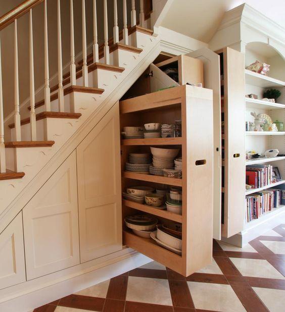 Concealed storage under staircase.